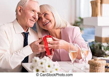 Two joyful senior people sharing a pleasant moment