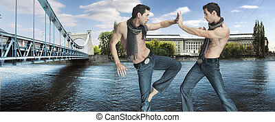 Two karate fighters kicking on the riverside
