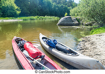 Two kayaks standing in water