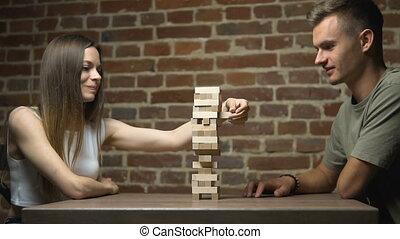 Two Keen Teens Play Jenga - Two caucasian keen friends...