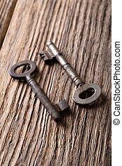 Two keys with rust on woden board