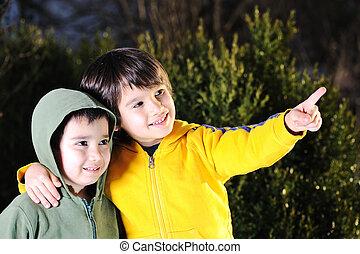 two kid boy is looking