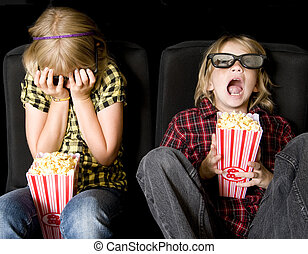 Two Kids at a Scary 3-D Movie - Frightened Boy and Girl...