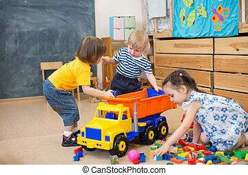 two kids conflict for toy truck in kindergarten