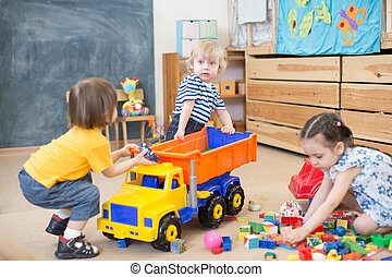 two kids conflict or struggling for toy truck in...
