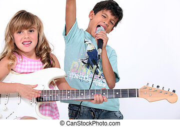 two kids doing a rock band