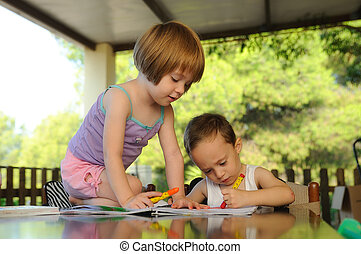 two kids drawing in a summer school