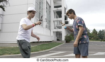 Two kids having a kendama contest in the schoolyard
