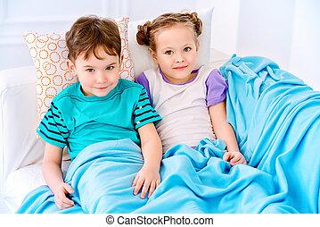 two kids in bedroom
