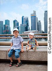 Two kids in big modern city