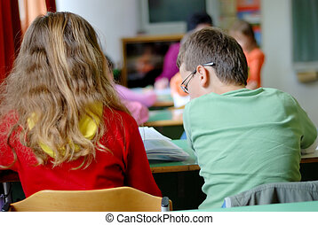 Two kids learning in the school