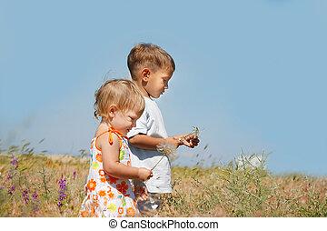 two kids playing in countryside