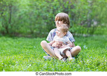 Two kids playing in the garden