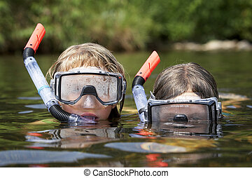 two kids playing in the water - two small and young children...