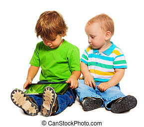 Two kids playing tablet