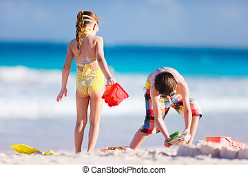 Two kids playing with sand