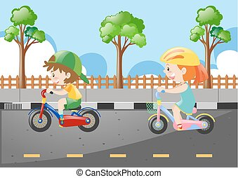 Two kids riding bicycle on the road