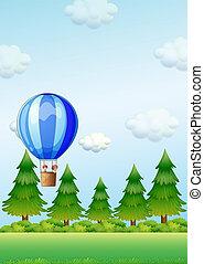 Two kids riding in an air balloon