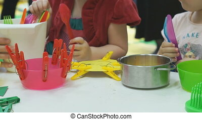Two kids sisters play together at a nursery school - Two...