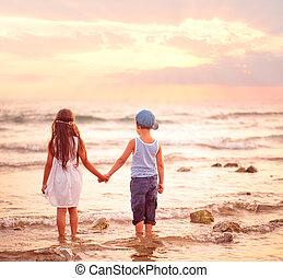 Two kids watching sunset.