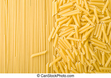 uncooked pasta - two kinds of uncooked pasta background