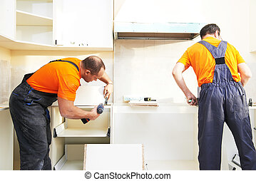 two kitchen installers at carpenter work