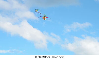 Two kites flying in blue sky