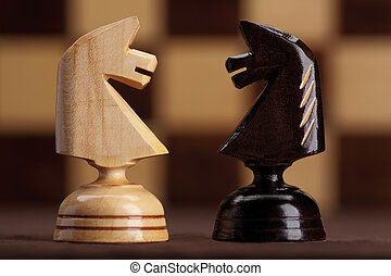two knight on chessboard background