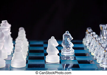 Two knights. - Set of chess withstands on the glass...