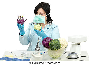 Masked expert carefully inspecting two kohlrabies in phytosanitary laboratory