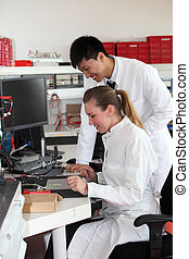 Two lab technologists at work