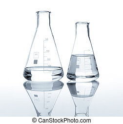 Two laboratory flasks with a clear liquid