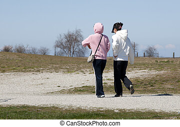 Two ladies walking in the park