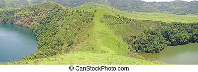 Two lakes blue and green between green hills - Cameroon - Africa - Panorama.