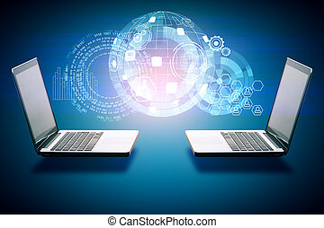 Data exchange concept - Two laptops with digital business...