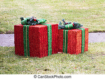 Two large Wrapped Christmas presant decorations outside on front lawn