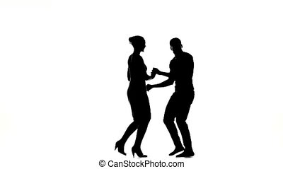 Two latino dancers in action, finishing dancing, silhouette, on white background