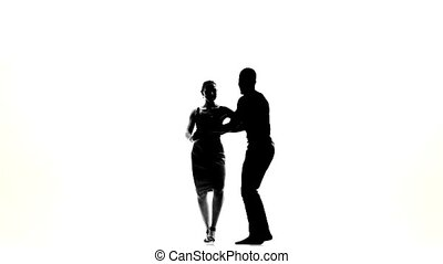 Two latino dancers in action, silhouette, on white, slow...