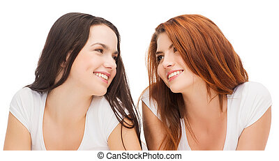 two laughing girls in white t-shirts