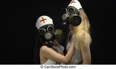Two lesbians nurses in gas mask