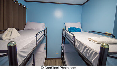 Two-level bed in a budget not expensive youth hostel.