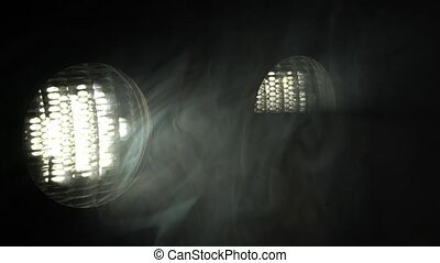 Two lights in a dark room
