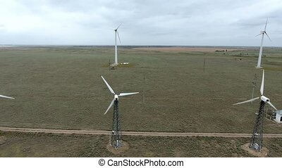 Two lines of wind power converters spinning fans on the...