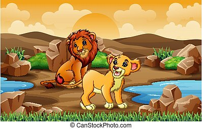 Two lions in the savannah field