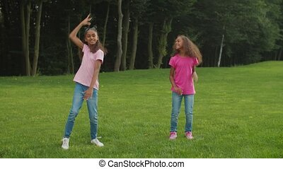 Two little african sisters dancing hip hop in park - Two ...