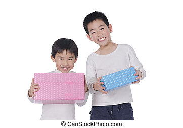 two little boy with gifts over white background