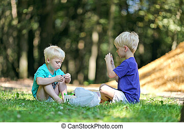 Two Little Boys Playing Outside in Dirt