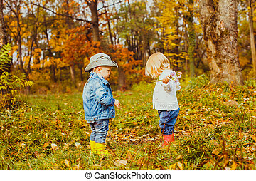 Two little boys standing in front of each other