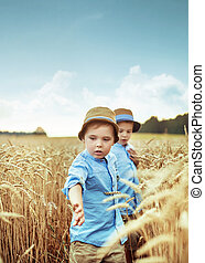 Two little brothers in the wheat field