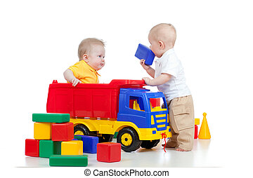 two little children playing with color toys